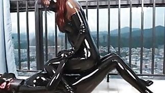Latex swishy rubbing with the addition of wanking off for orgasm